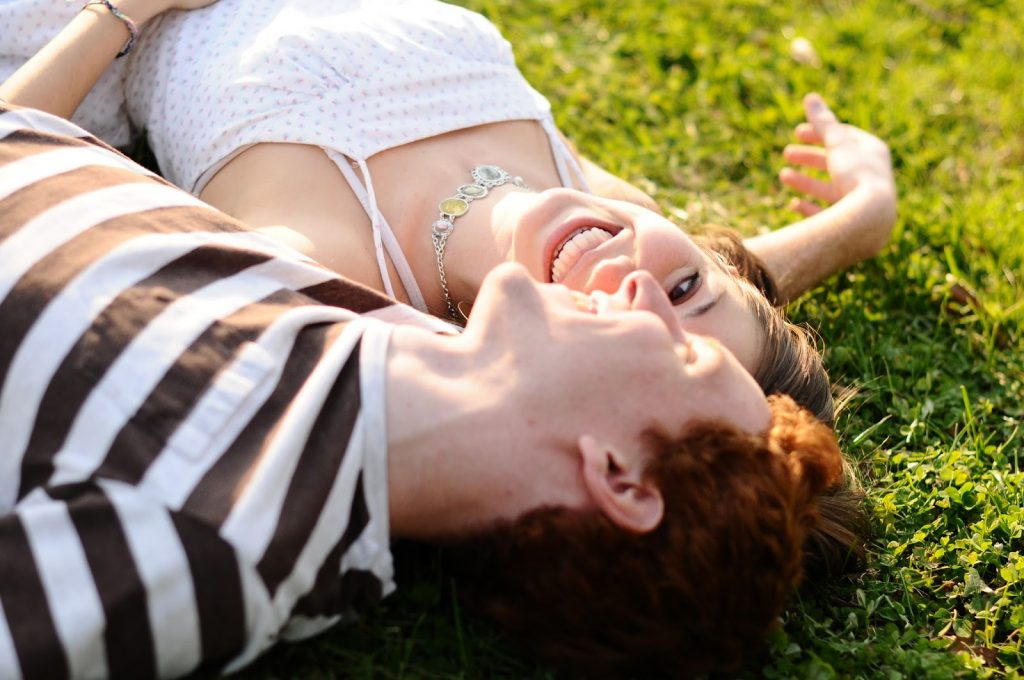 What's more fun than laughing in the grass together? Photo thanks toDavey.