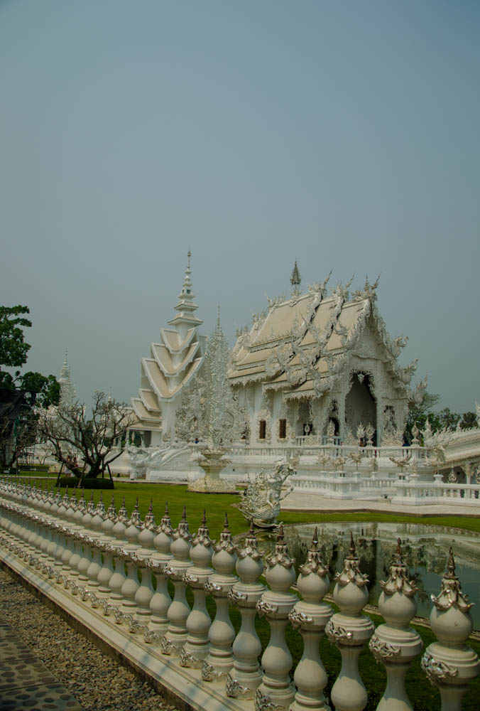 visiting the white temple in chiang rai. the main temple building seen from the outside