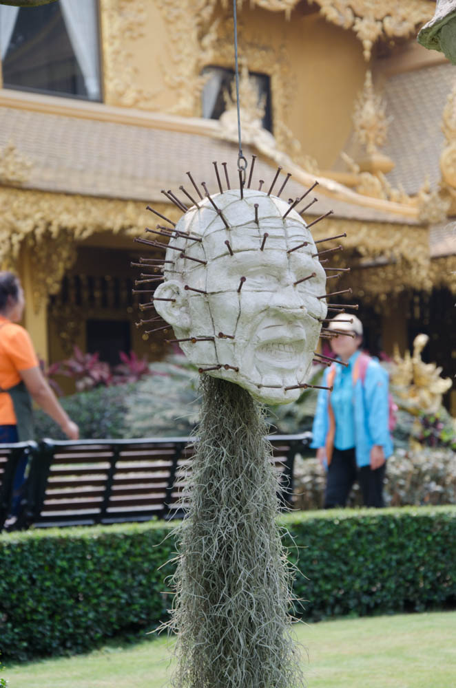 a head with nails at the white temple in chiang rai