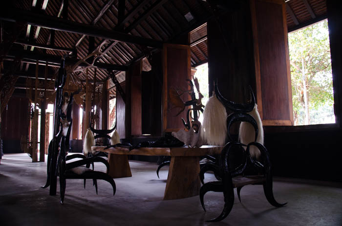 a table and chairs made out of bones and animal skin at the black house, chiang rai