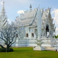 a white temple in chiang rai seen from the outside