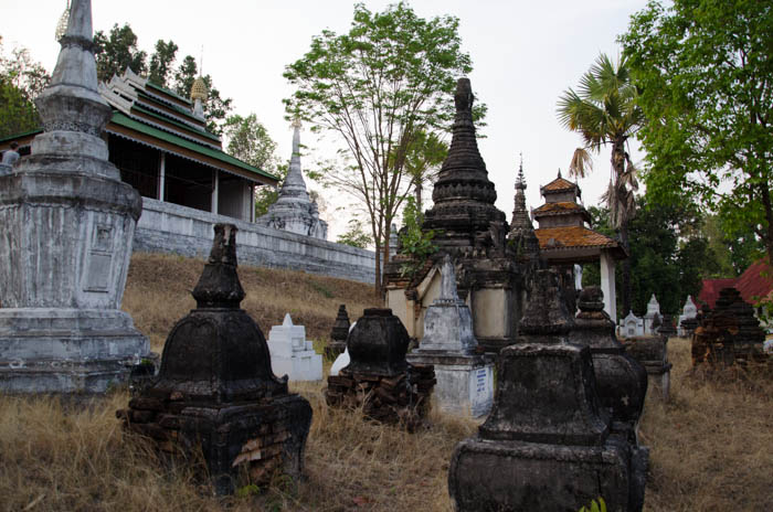 graves and stupas at a buddhist cemetery in mean hong song thailand