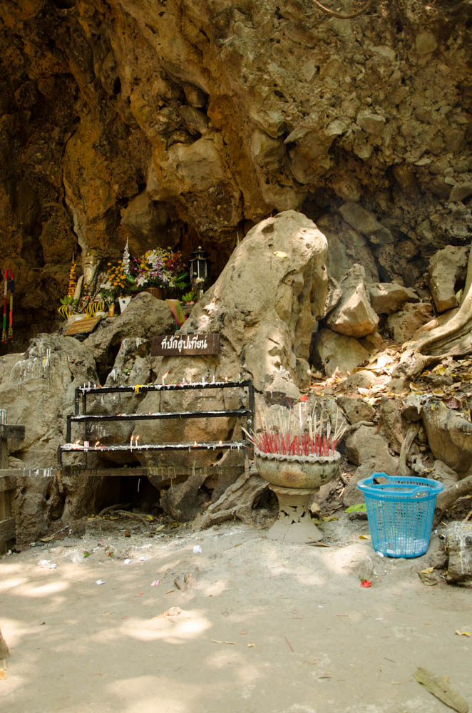 the entrance to the cave with candles and incense in mean hong song, thailand