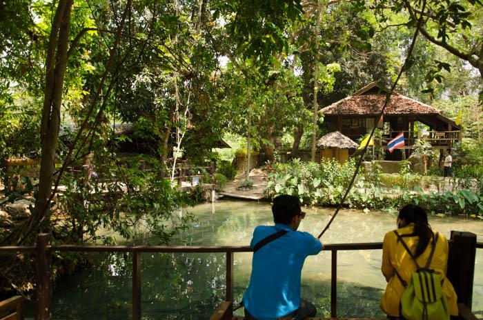 a pond near a cave in mea hong song, thailand