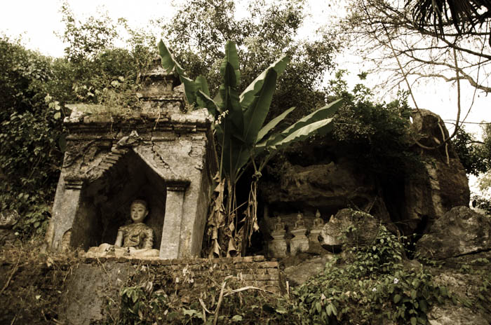 temple ruins and old buddha statue near chiang dao cave, thailand