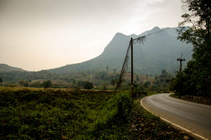 a bend at the road in the mountains of chiang dao, thailand