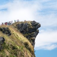 people standing on the edge of the phu chi fa mountain