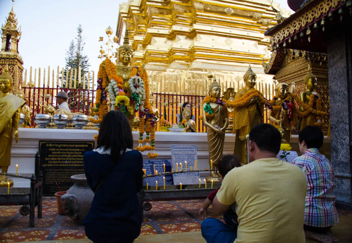 Family praying at the Doi Suthep temple, Chiang Mai