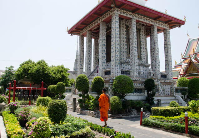 A monk walking in the gardens in Wat Arun