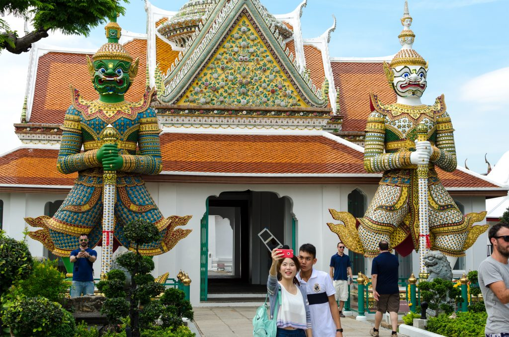 Giant statues in front of a gate at Wat Arun in Bangkok