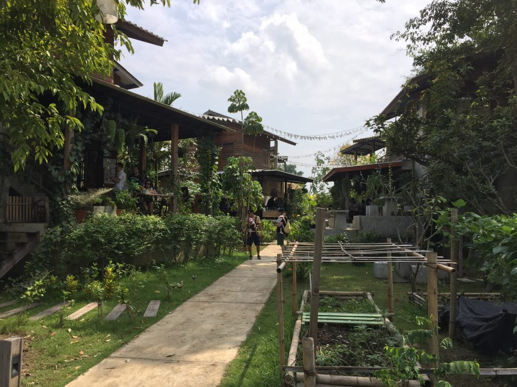 Lush, green gardens at Baan Kang Wat in Chiang Mai