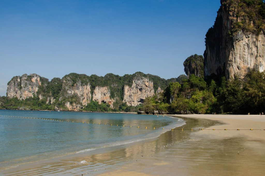Railay Beach is famous for being surrounded by tall limestone cliffs