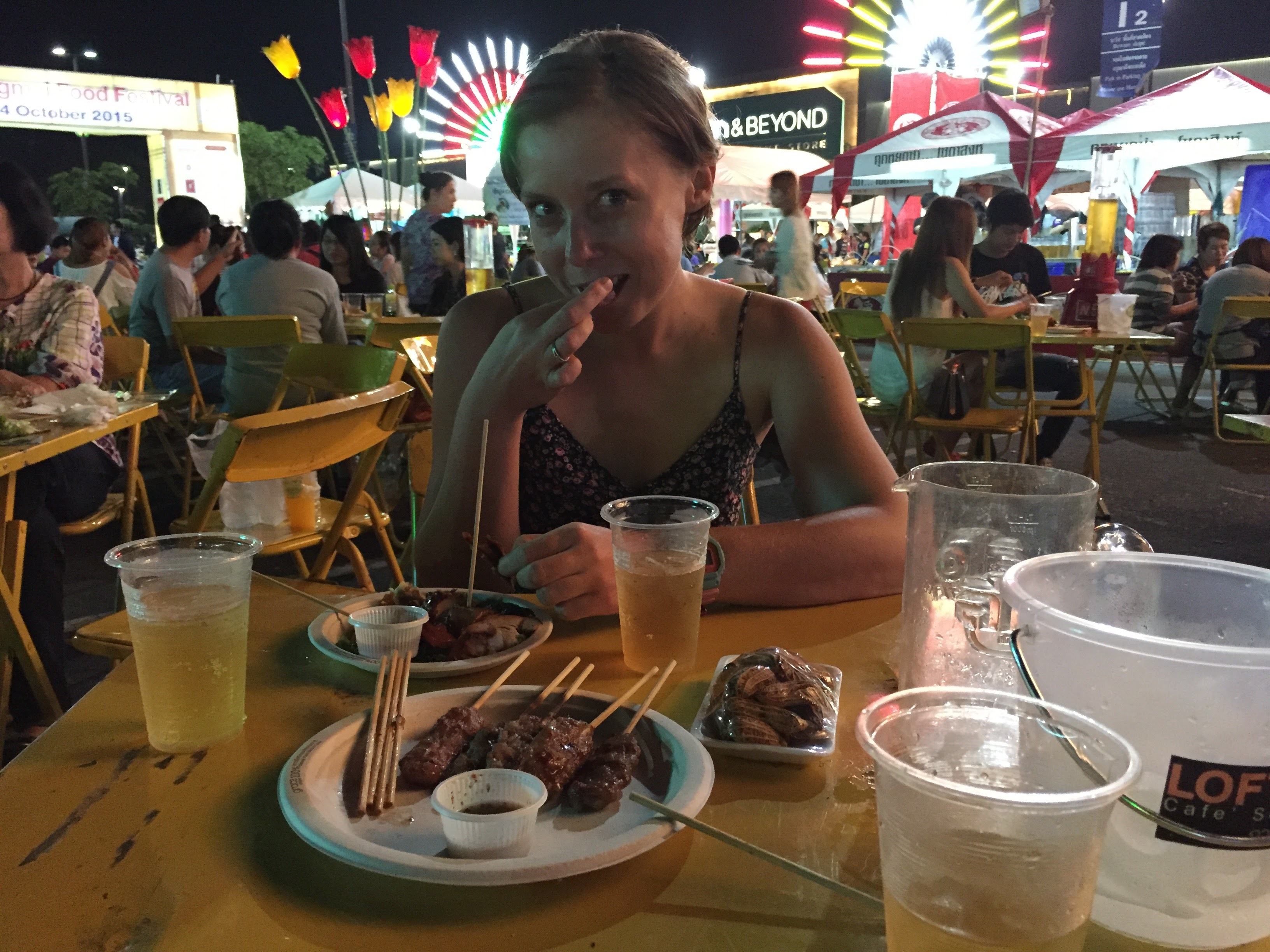 Travel healthy - a girl eating at a local restaurant in Thailand.