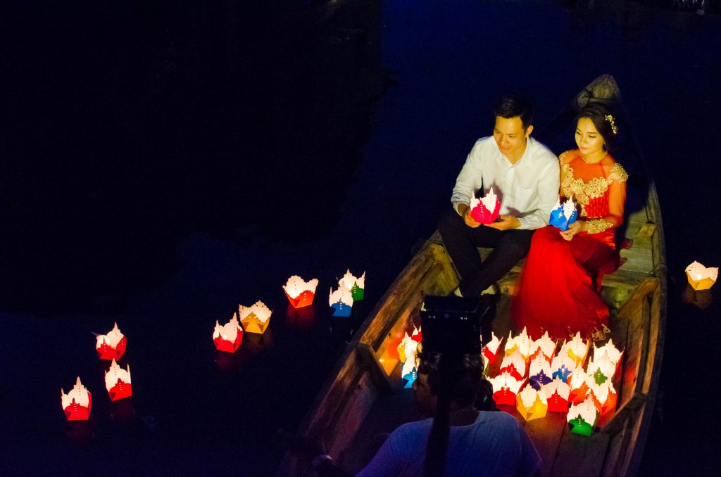 Couple during a photoshoot at the Japanese Bridge in Hoi An