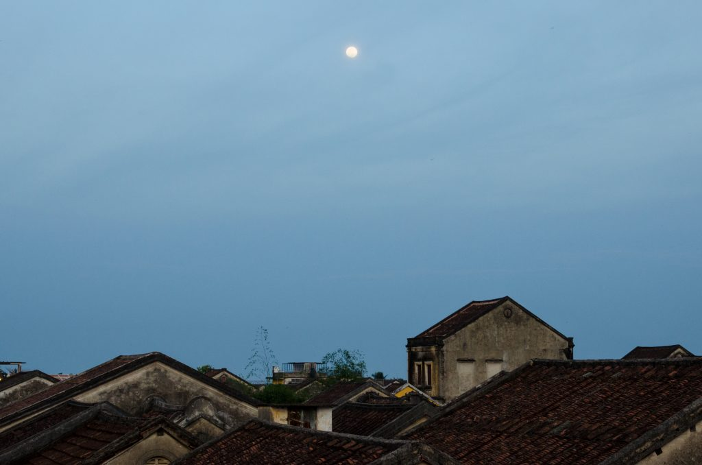 View over the roofs of Hoi An with full moon in the sky