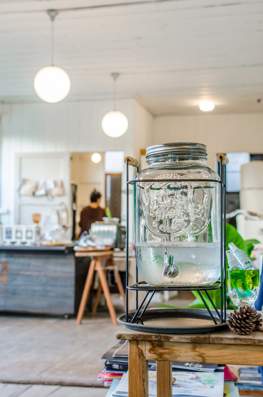 Water dispenser and counter at Bulbul Book Café in Chiang Mai