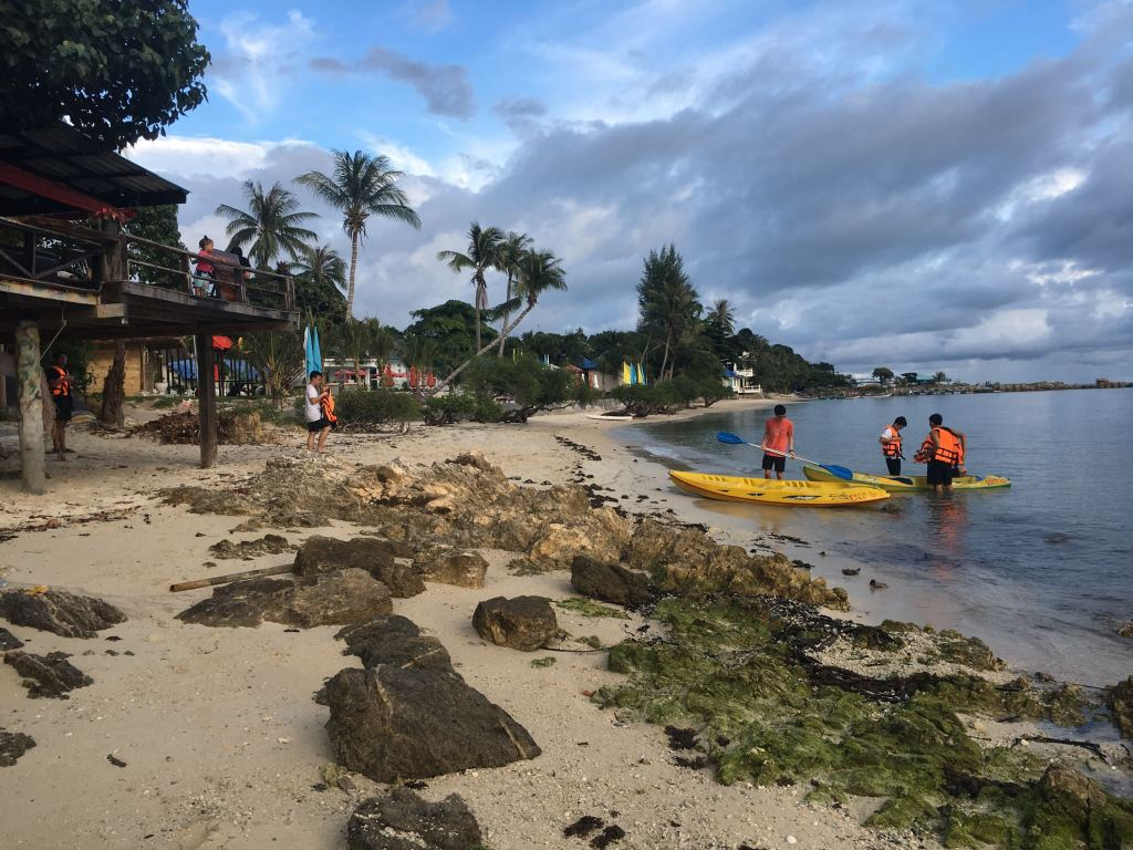 Sunset Beach, Had Rin, Koh Phangan, Thai boys kayaking