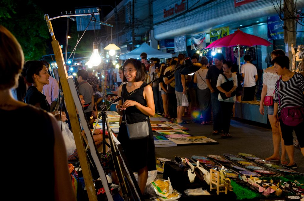 Shopping for paintings by local artists at the Sunday Night Market in Chiang Mai