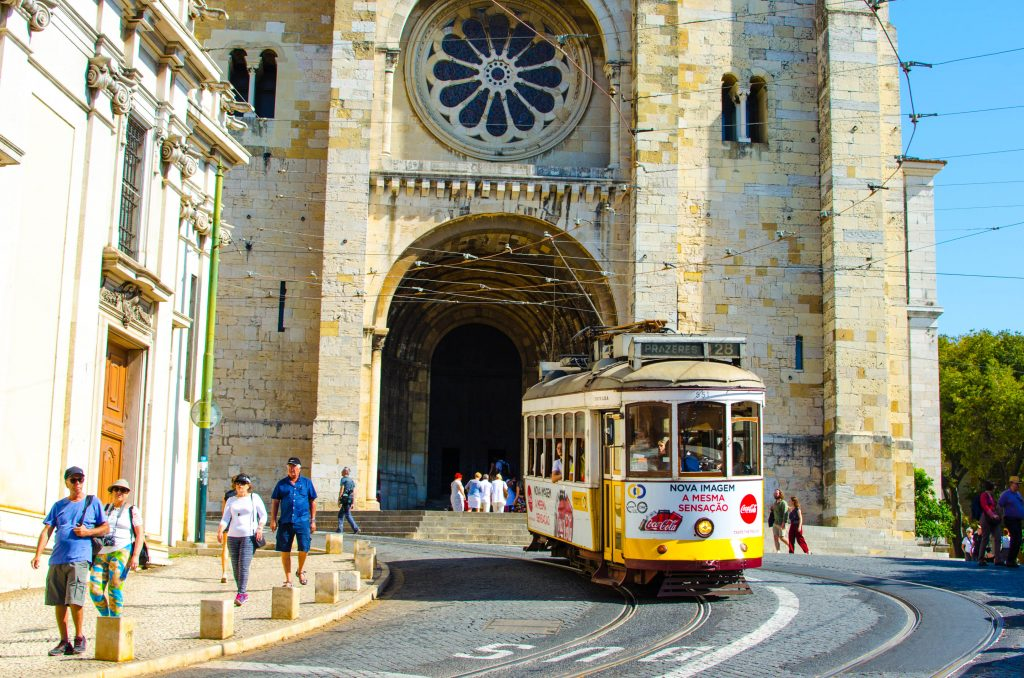 tram 28 passing a church in lisbon