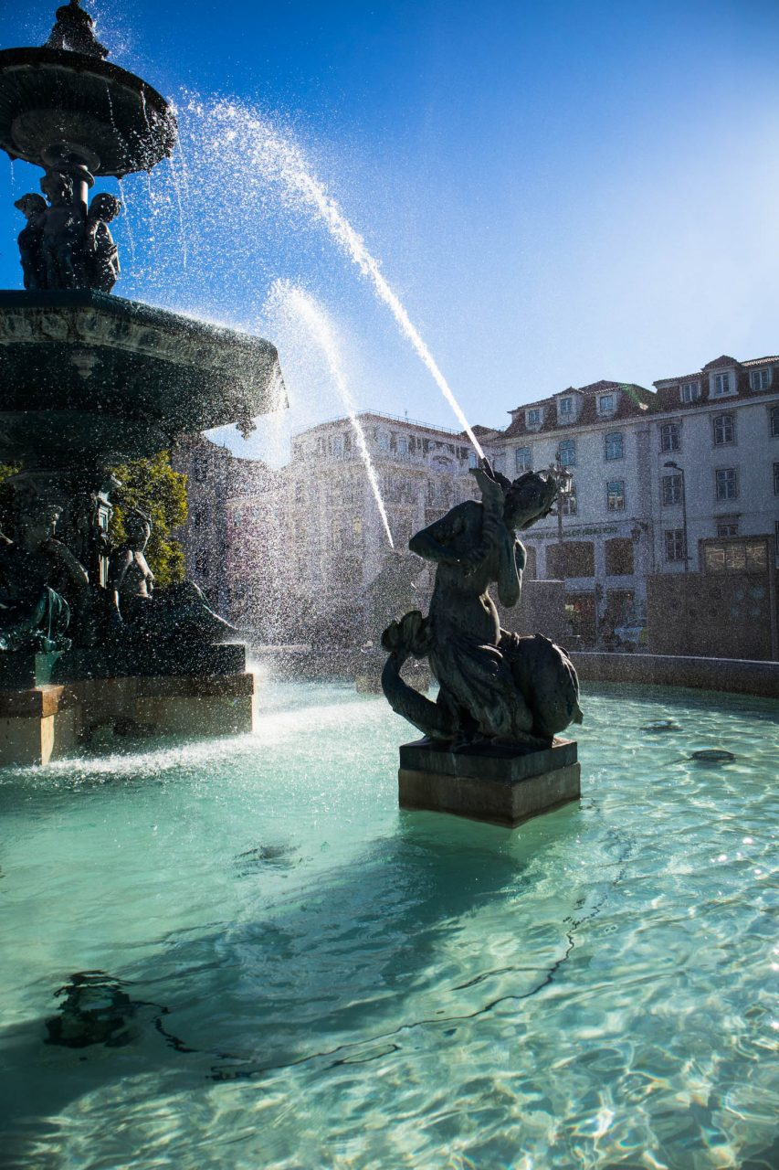 a sculpture in the fountains on rossio square in lisbon