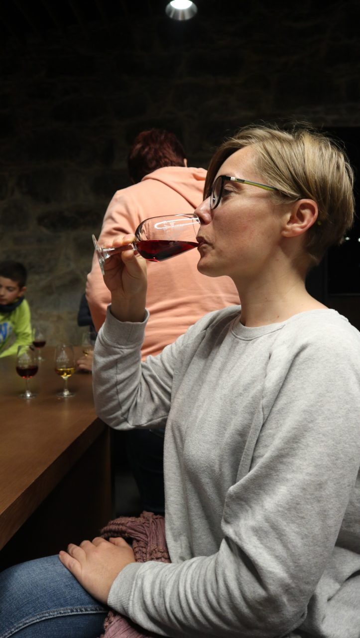 joanna drinks port in porto's wineries.