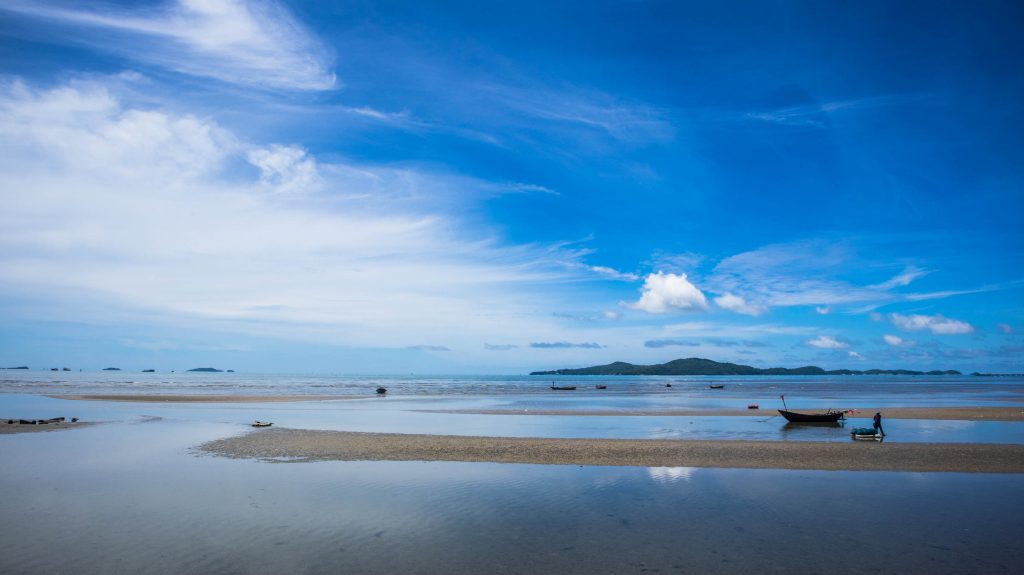 fishing boat in the horizon in rayong, thailand