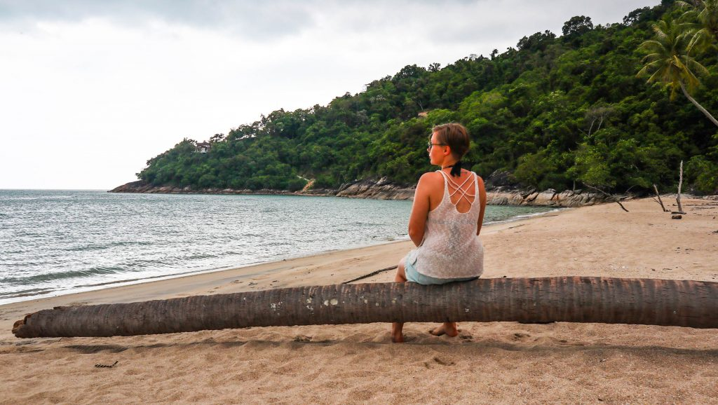 joanna sitting on a beach in khanom