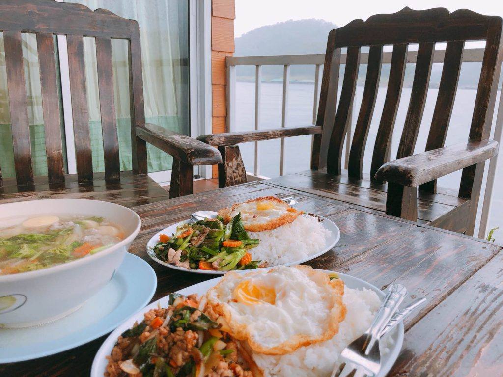 rice with fried pork and soup with pork on mae ngat dam thailand