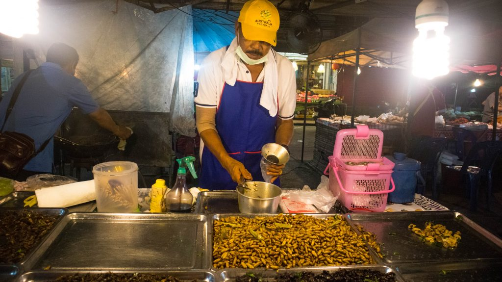 street seller at the night market in khanom