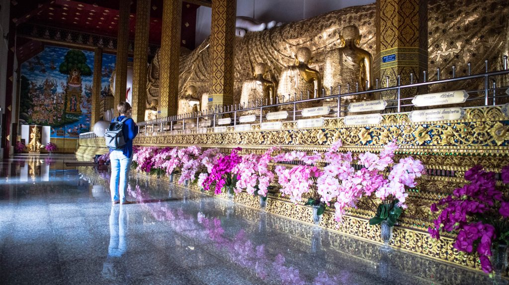 joanna at the reclining buddha statue in blue temple mae taeng