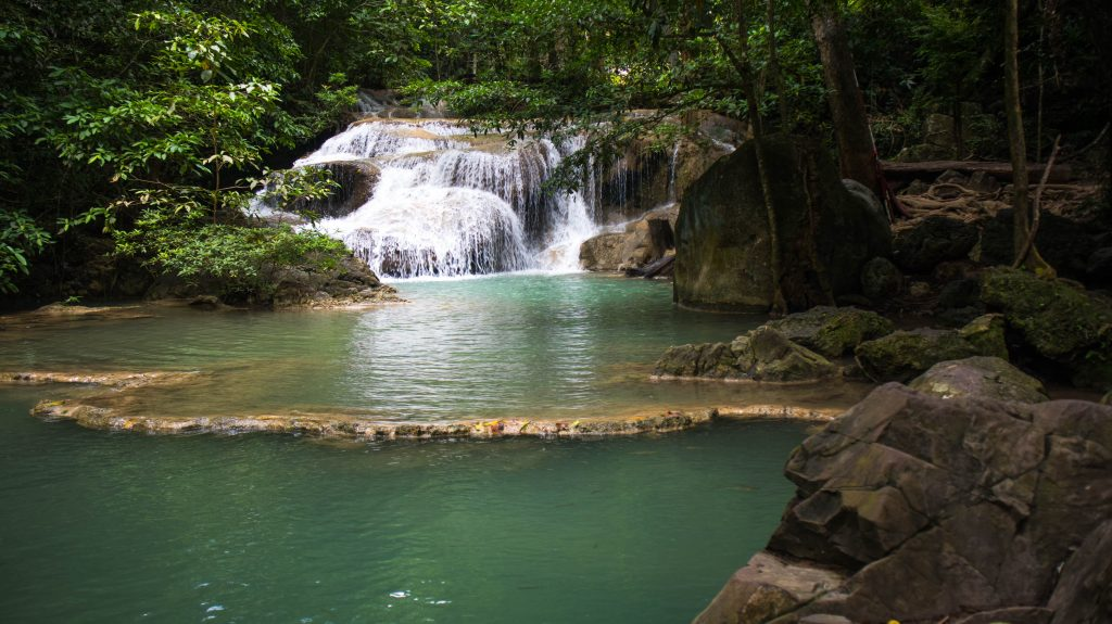 erawan waterfall water cascading into a pool