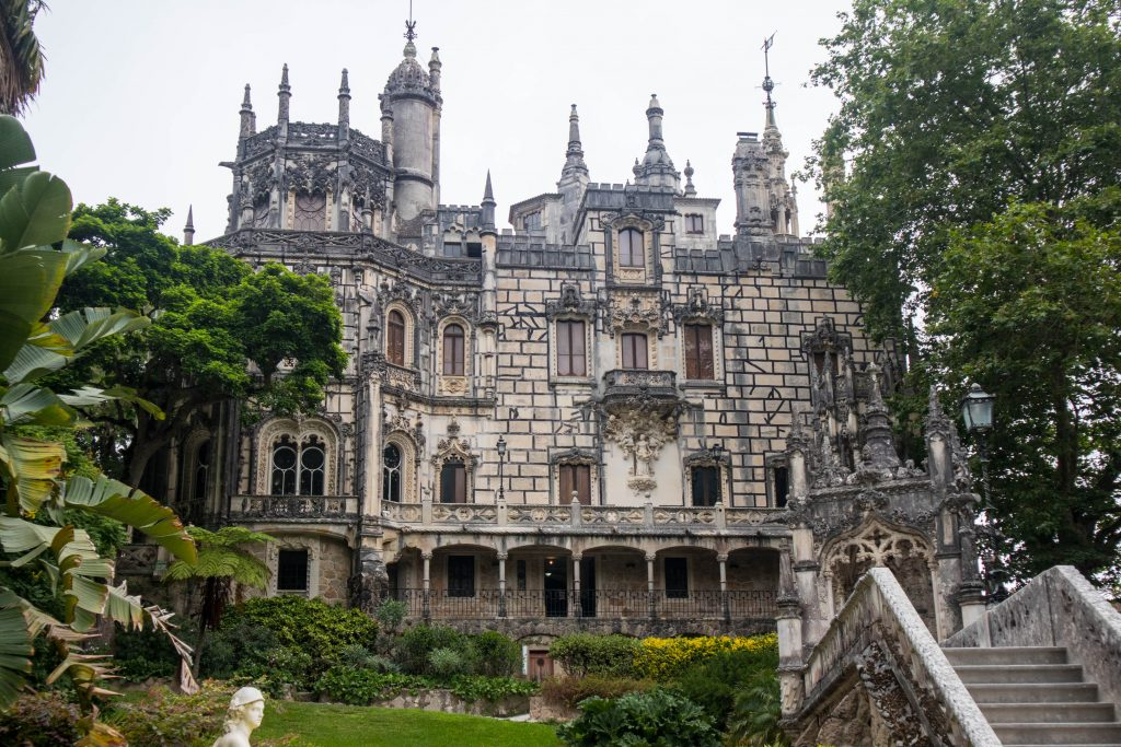 the palace of quinta de regailera in sintra seen from the outside surrounded by garden