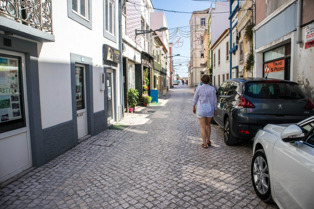 joanna walking on the streets in peniche, portugal