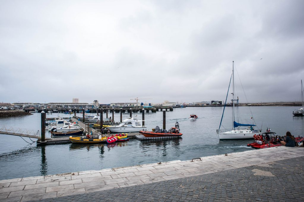 small port with a few boats in peniche, portugal