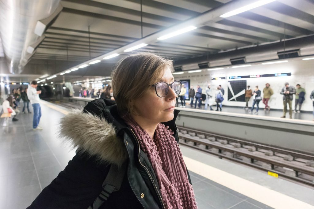 a girl on a platform in lisbon metro