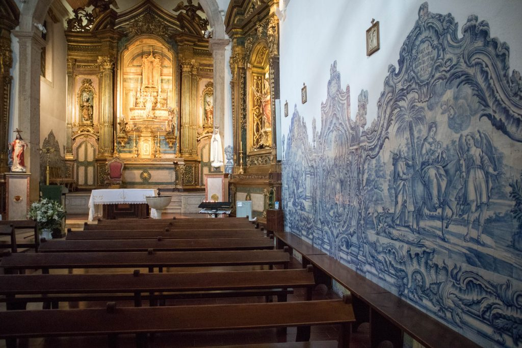 azulejos and an altar in a small church in cacilhas