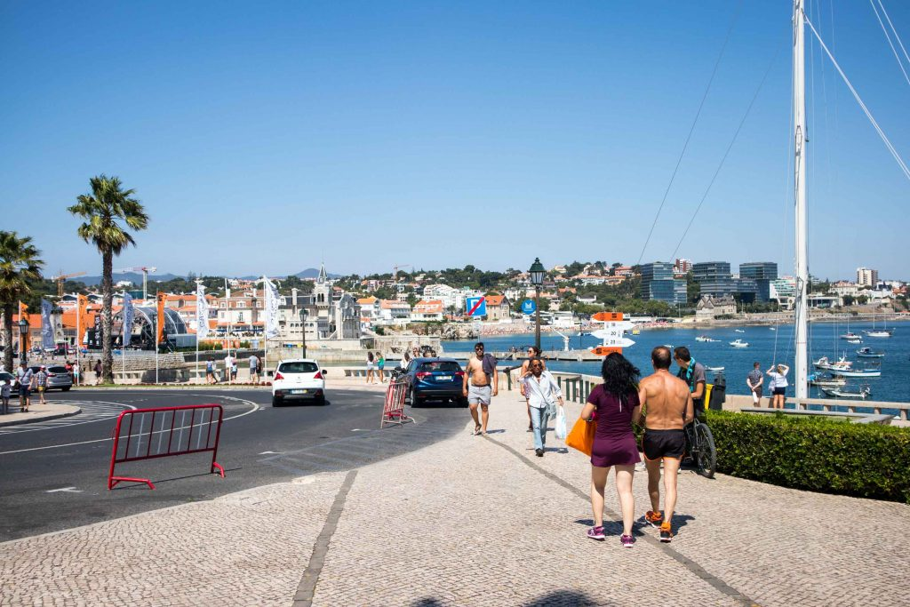 people walking on a busy street in cascais.