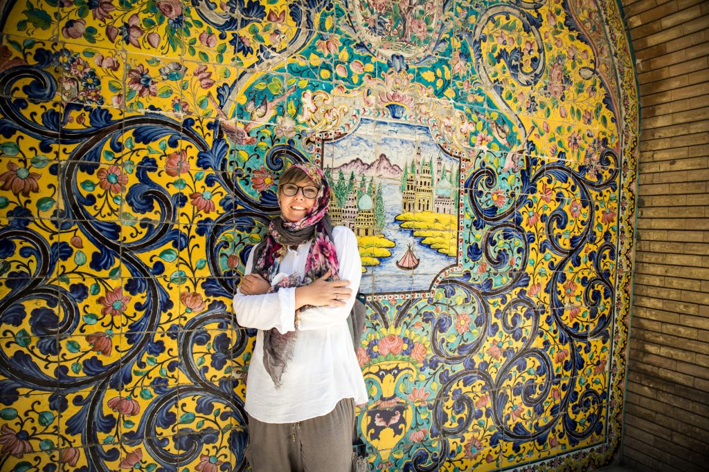 a smiling girl in golestan palace