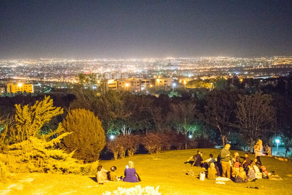 people sit on a soffeh mountain at night in esfahan iran
