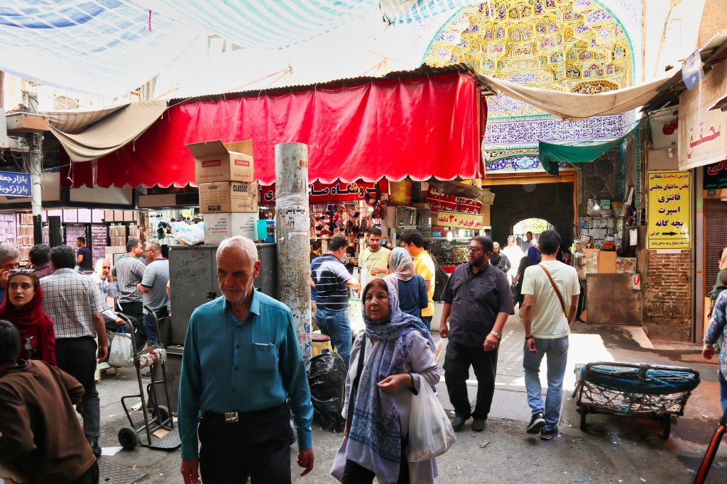 iranian couple walks through the grand bazaar in iran