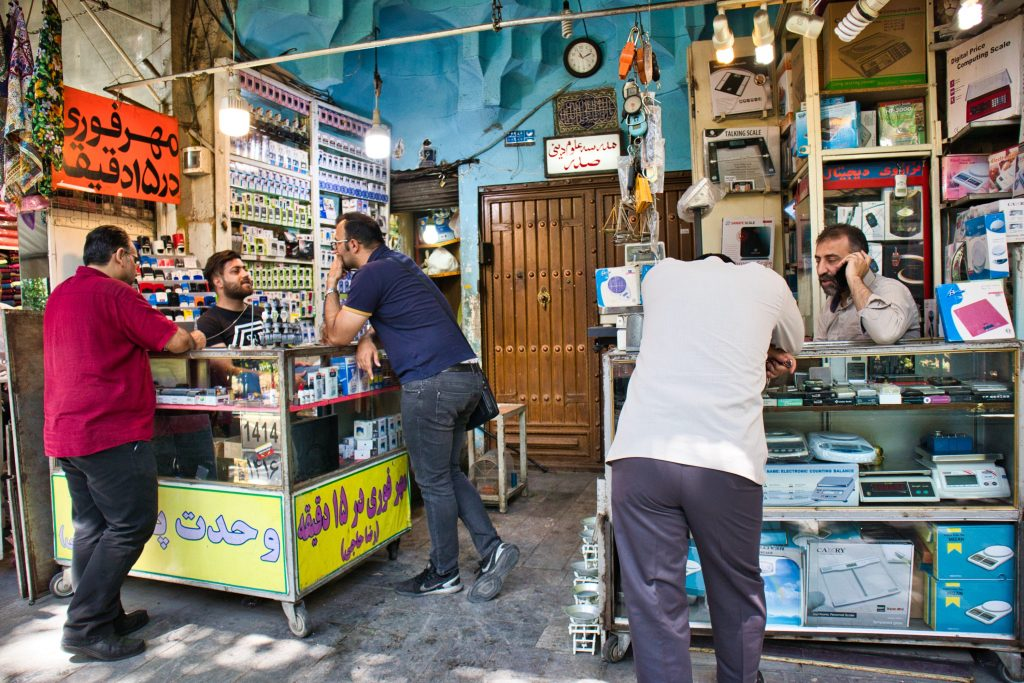 men selling phones and electronics at grand bazaar teheran