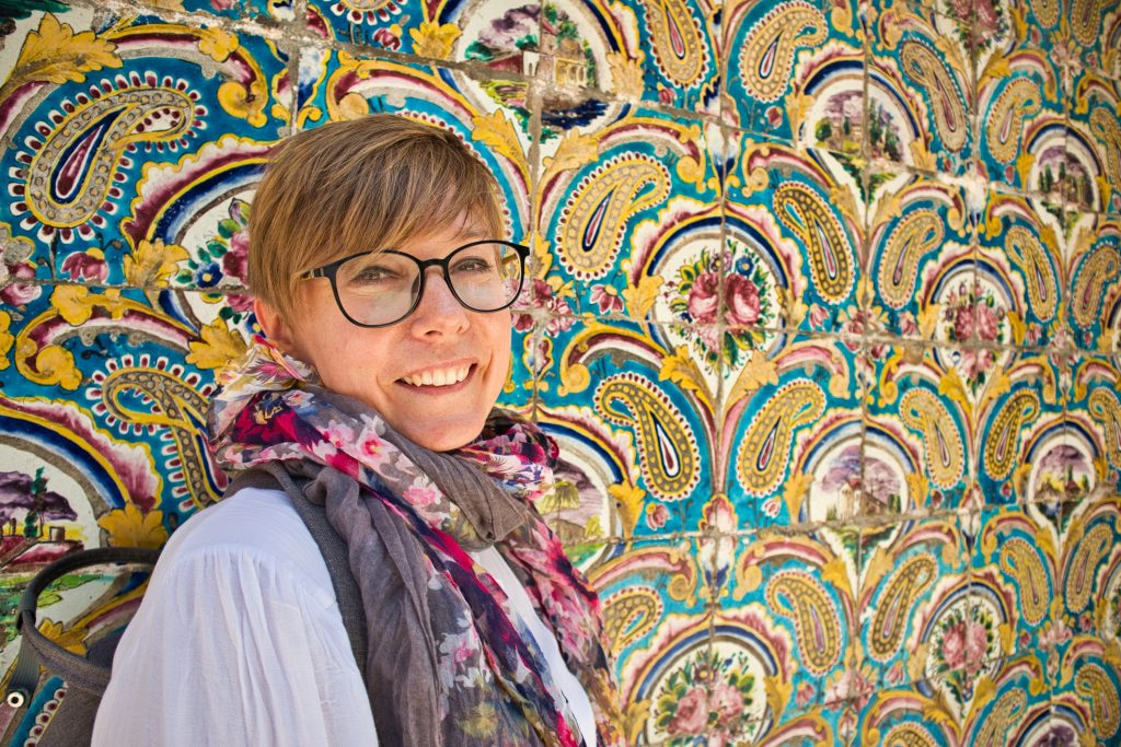 a girl with a beautiful wall in iran