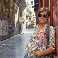 joanna horanin smiles at the camera on an empty street in valencia