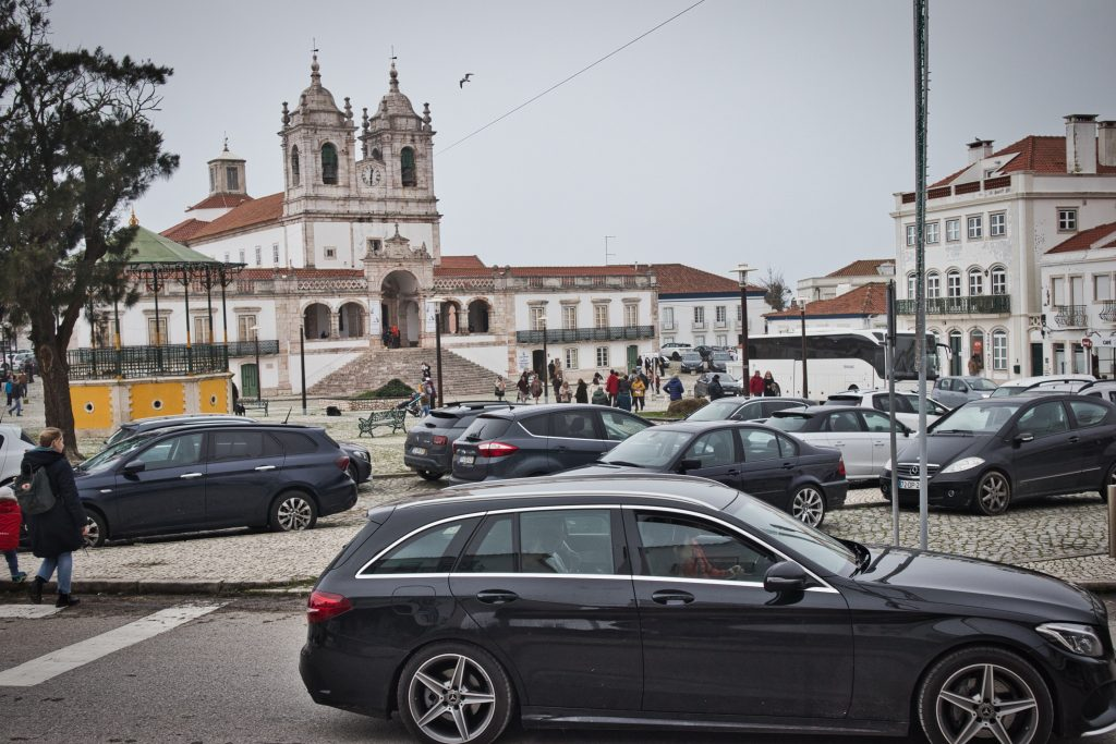 parking in nazare filled with cars near the main square