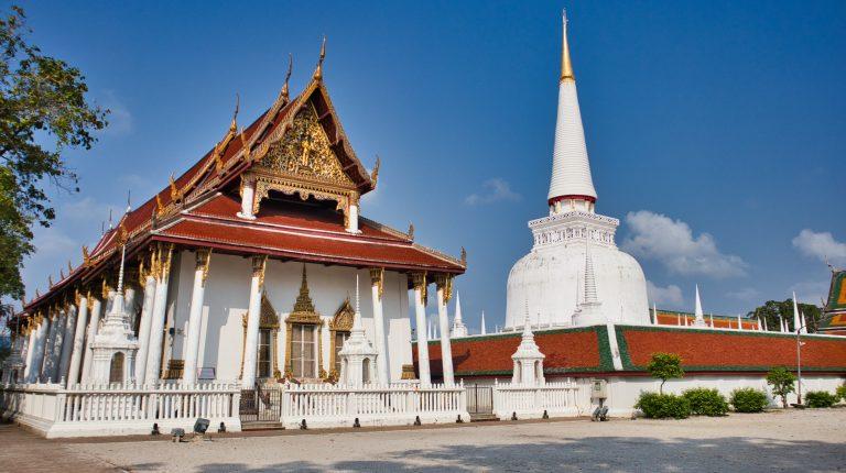 a thai temple in nakhon si thammarat with a white chedi