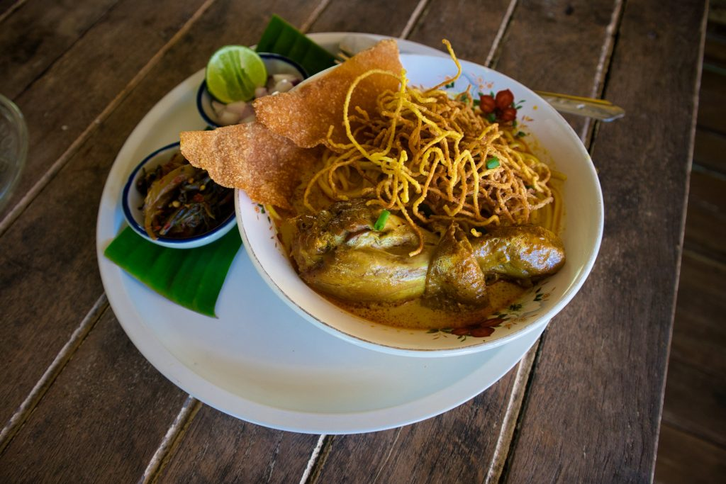 a plat of khao soi on a white plate.