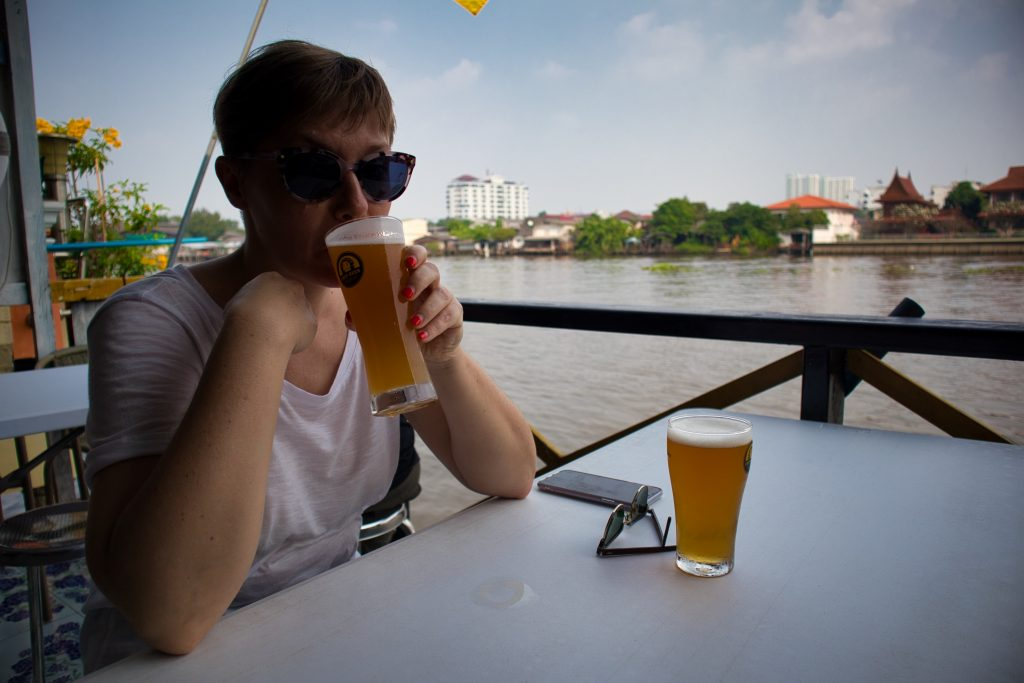 a woman drinks a kraft beer at Chit Beer, on Koh Kret, Bangkok.