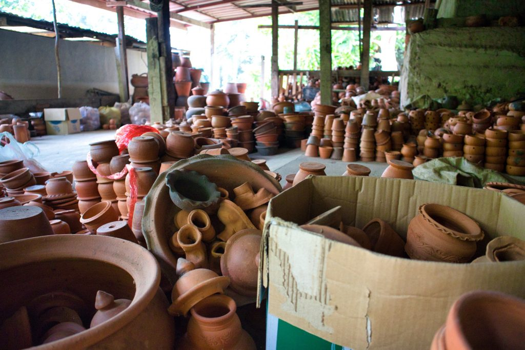 pottery bowls and cups laying in a pile, in a box, on koh kret island in bangkok.