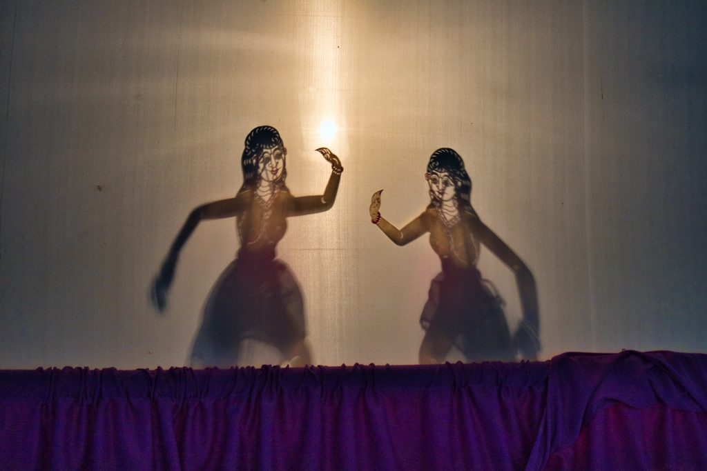two shadow puppets in the puppet theatre in nakhon si thammarat in thailand