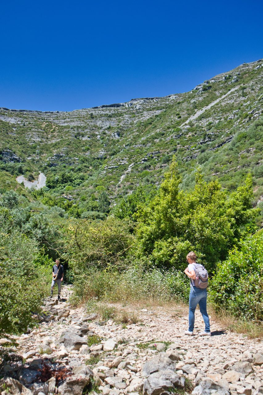 a woman and a man trekking in a natural park in portugal